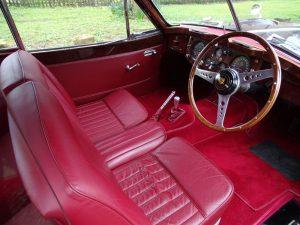 Red interior of 1956 Jaguar XK140